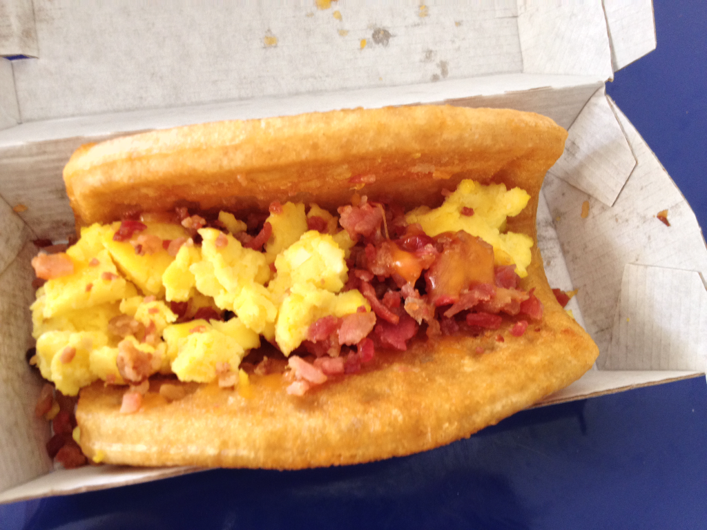 Taco Bell Breakfast Waffle Taco with Bacon inside close up