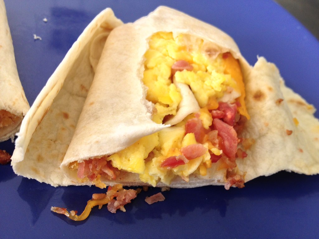 Taco Bell Breakfast  Breakfast Burrito with Bacon inside close up